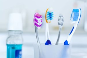 A cup of toothbrushes