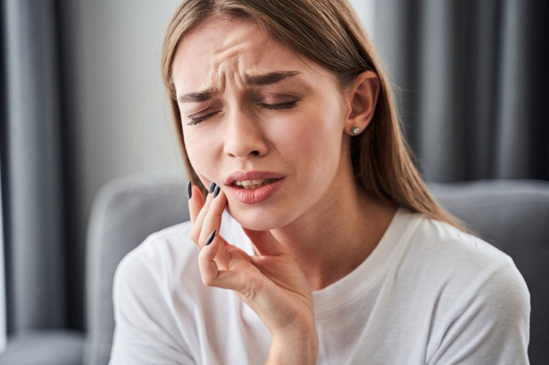 young woman with dental emergency